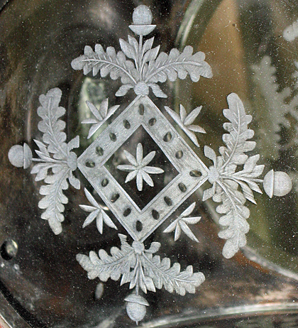 Oak and acorn pattern on cut glass lantern.