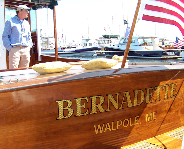 Engine turned gold name Burnadette with builder Pete Kass of John's Bay Boat.