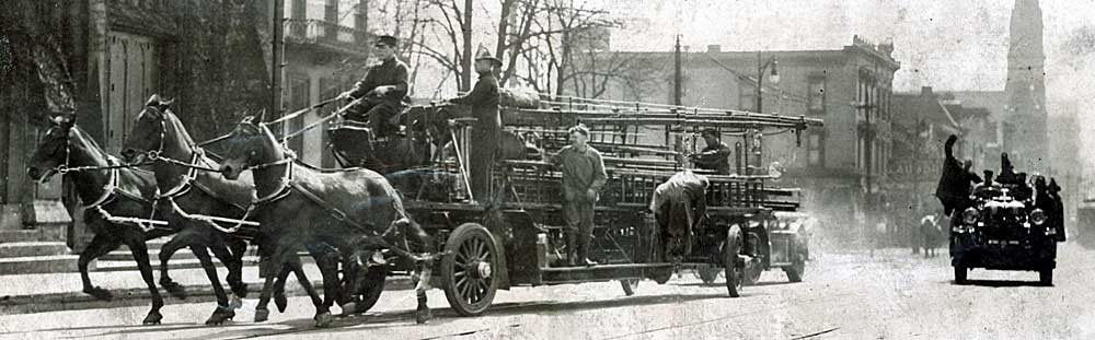 Horses leading the motorized engines to the fire.