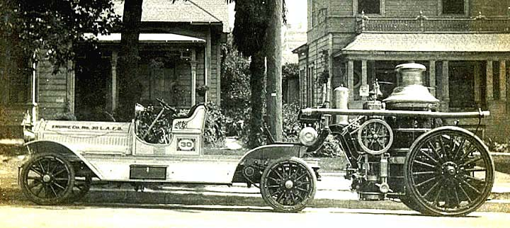 1913 Seagrave tractor pulling steam fire engine.