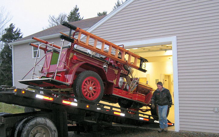 1925 American LaFrance fire engine leaving the Fire Gold shop.