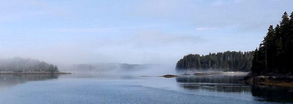 Northeast Harbor, Maine with the fog lifting.