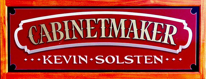 Gilded sign with a mahogany frame for Kevin Solsten Cabinetmaker.