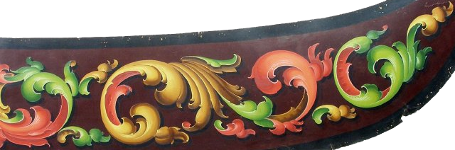 Colored and gold scrolls on Concord coach panel. These are similar to scrolls surrounding European coats of arms.