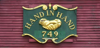 Hand-In-Hand sign on restoration shop.