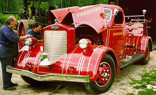 Andy Swift tuning up 1939 American LaFrance fire engine