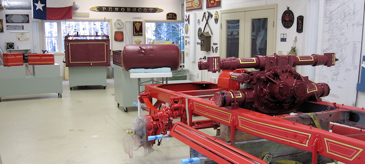 Fire Gold shop interior with American LaFrance frame and pump.