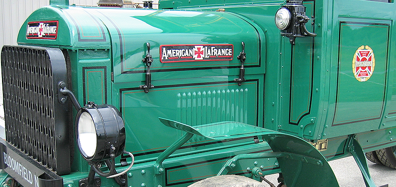 Black stripes and red lines on green American LaFrance commercial truck restoration