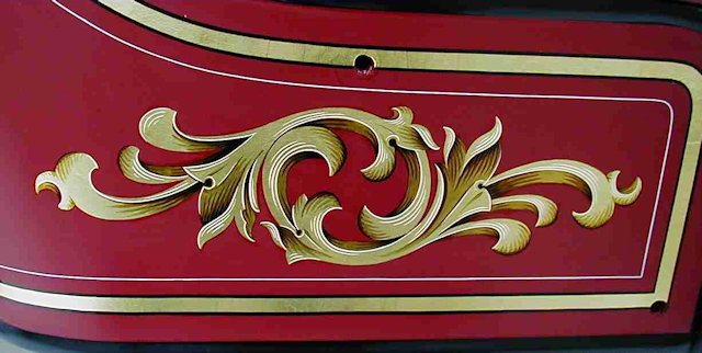 Hand painted Ahrens-Fox seat scroll by Peter Achorn.