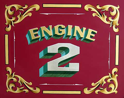 Restored lettering on seat of 1936 Ahrens-Fox fire engine.