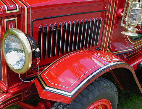 Chevron cut into the front fender of 1923 Maxim fire engine.