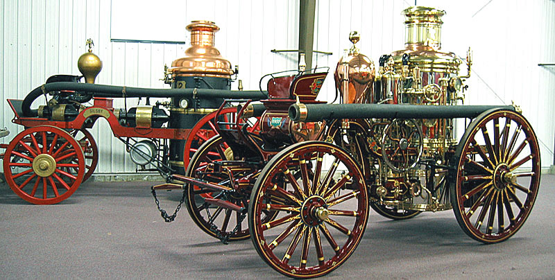 Two steam fire engines, one restored by Firefly Restoration