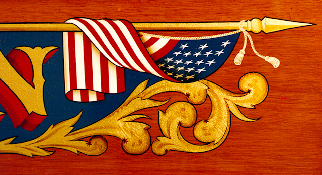 1857 American flag hand painted with gold leaf scroll and lettering.